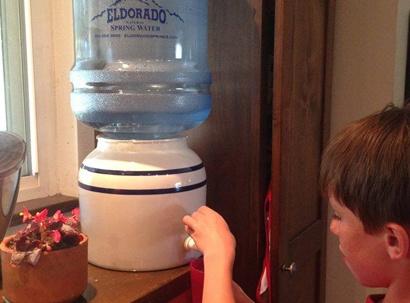 Child dispenses Eldorado Water at home
